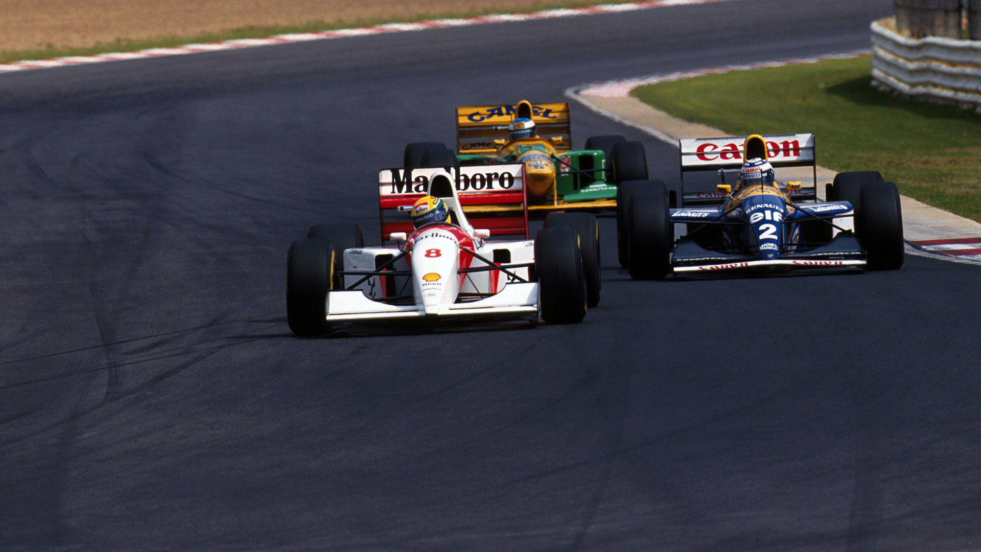 Ayrton Senna, Alain Prost and Michael Schumacher racing each other.