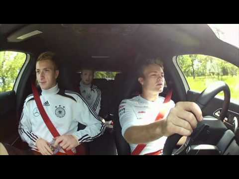 Nico Rosberg and Michael Schumacher visiting german national football team EURO 2012
