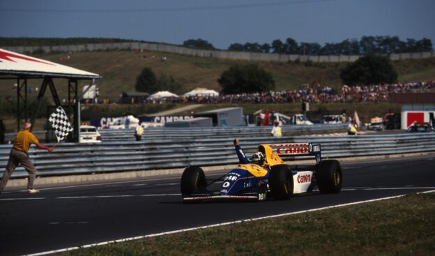 Damon Hill, Williams FW 15C takes the chequered flag for his first Grand Prix victory. Hungarian Grand Prix, Hungaroring, 15 August 1993.