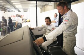 Fernando Alonso and Jenson Button in the garage.