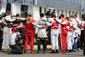 The drivers observe the tribute to Jules Bianchi on the grid.