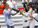 Lewis Hamilton shares his Champagne with Justin Bieber at the podium