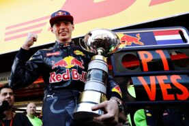 Max Verstappen celebrates his win with his trophy during the Spanish Formula One Grand Prix at Circuit de Catalunya on May 15, 2016