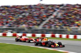 Daniel Ricciardo in his Red Bull RB12 leads Sebastian Vettel in his Ferrari SF16-H at Canada