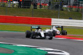 Lewis Hamilton in his Mercedes W07 followed by Felipe Massa in his Williams FW38 on Silverstone