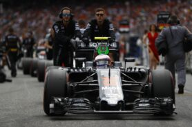 Jenson Button is pushed onto the grid.