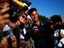 SPA, BELGIUM F1/2016: Daniel Ricciardo of Red Bull Racing poses for photographs with fans during previews.
