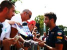 MONZA, ITALY F1/2016: Daniel Ricciardo of Red Bull Racing signs autographs for fans.