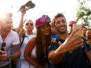 MONZA, ITALY F1/2016: Daniel Ricciardo of Red Bull Racing arrives at the circuit and poses for a photo with fans.