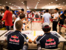 Daniil Kvyat and Carlos Sainz sign autographs for fans during previews ahead of the F1 GP of Singapore at Marina Bay Street Circuit 2016