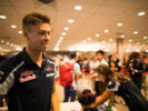 Daniil Kvyat signs autographs for fans during previews ahead of the F1 GP of Singapore at Marina Bay Street Circuit 2016