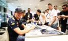 Max Verstappen signs autographs for fans during previews ahead of the Formula One Grand Prix of Singapore at Marina Bay Street Circuit 2016
