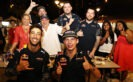 Daniel Ricciardo, Max Verstappen at Newton Food Centre with a group of competition winners.