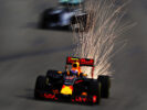 Sparks fly behind Max Verstappen on track during final practice for the Formula One Grand Prix of Singapore 2016
