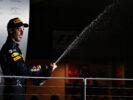 Daniel Ricciardo celebrates on the podium during the Formula One Grand Prix of Singapore 2016
