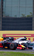Lewis Hamilton locks a wheel under braking as he tries to overtake Max Verstappen on track during the Formula One Grand Prix of Japan 2016