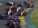 Romain Grosjean driving the (8) Haas VF-17 leads Daniil Kvyat of driving the (26) Scuderia Toro Rosso STR12 and Carlos Sainz of Spain driving the (55) Scuderia Toro Rosso STR12 at the start during the Australian Formula One Grand Prix at Albert Park on March 26, 2017 in Melbourne, Australia.