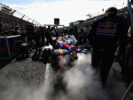 Smoke pours out of the back of the car of Daniil Kvyat of Russia Scuderia Toro Rosso STR12 on the grid during the Australian Formula One Grand Prix at Albert Park on March 26, 2017 in Melbourne.
