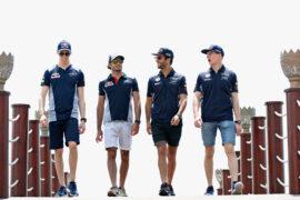 Daniil Kvyat, Carlos Sainz, Daniel Ricciardo and Max Verstappen walk during previews to the Bahrain Formula One Grand Prix at Bahrain International Circuit on April 13, 2017 in Bahrain, Bahrain.