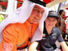 Max Verstappen of Red Bull Racing poses for a photo with a fan during final practice for the Bahrain Formula One Grand Prix at Bahrain.