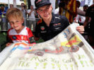 Max Verstappen of Red Bull Racing poses for a photo with a young fan during final practice for the Bahrain Formula One Grand Prix at Bahrain 2017
