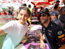 Daniel Ricciardo of Red Bull Racing poses for a photo with a fan during final practice for the Bahrain Formula One Grand Prix at Bahrain International Circuit on April 15, 2017 in Bahrain, Bahrain.