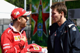 Sebastian Vettel of Ferrari talks with Daniil Kvyat of Scuderia Toro Rosso in the Paddock during previews for the Spanish Formula One Grand Prix at Circuit de Catalunya on May 11, 2017 in Montmelo, Spain.