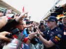 Max Verstappen of Red Bull Racing signs autographs for fans during previews for the Spanish Formula One Grand Prix at Circuit de Catalunya on May 11, 2017 in Montmelo, Spain.