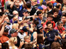 Daniel Ricciardo of Red Bull Racing takes a selfie with fans during previews for the Spanish Formula One Grand Prix at Circuit de Catalunya on May 11, 2017 in Montmelo, Spain.