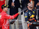 Race winner Sebastian Vettel of Germany and Ferrari celebrates with third place finished Daniel Ricciardo of Australia and Red Bull Racing on the podium during the Monaco Formula One Grand Prix at Circuit de Monaco on May 28, 2017 in Monte-Carlo, Monaco.