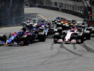 Carlos Sainz of Spain driving the (55) Scuderia Toro Rosso STR12 leads Sergio Perez of Mexico driving the (11) Sahara Force India F1 Team VJM10 at the start during the Monaco Formula One Grand Prix at Circuit de Monaco on May 28, 2017 in Monte-Carlo, Monaco.