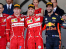 Top three finishers Sebastian Vettel of Germany and Ferrari, Kimi Raikkonen of Finland and Ferrari and Daniel Ricciardo of Australia and Red Bull Racing on the podium during the Monaco Formula One Grand Prix at Circuit de Monaco on May 28, 2017 in Monte-Carlo, Monaco.
