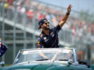 Daniel Ricciardo of Australia and Red Bull Racing waves to the crowd on the drivers parade during the Canadian Formula One Grand Prix at Circuit Gilles Villeneuve on June 11, 2017 in Montreal, Canada.