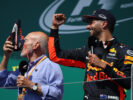 Actor Sir Patrick Stewart celebrates on the podium with Daniel Ricciardo of Australia and Red Bull Racing and a shoey during the Canadian Formula One Grand Prix at Circuit Gilles Villeneuve on June 11, 2017 in Montreal, Canada.