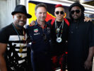 Red Bull Racing Team Principal Christian Horner poses for a photo with the Black Eyed Peas, (left to right) apl.de.ap, Taboo and will.i.am before qualifying for the Azerbaijan Formula One Grand Prix at Baku City Circuit on June 24, 2017 in Baku, Azerbaijan.