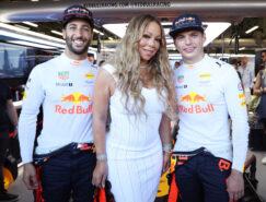 Singer Mariah Carey poses with Red Bull Racing drivers Daniel Ricciardo (L) of Australia and Max Verstappen of the Netherlands prior to the Azerbaijan Formula One Grand Prix at Baku City Circuit on June 25, 2017 in Baku, Azerbaijan.