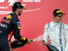 Race winner Daniel Ricciardo of Australia and Red Bull Racing celebrates his win on the podium with third placed finisher Lance Stroll of Canada and Williams during the Azerbaijan Formula One Grand Prix at Baku City Circuit on June 25, 2017 in Baku, Azerbaijan.
