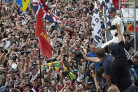 Lewis Hamilton on the podium in Silverstone after winning for the 5th time