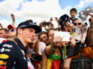 Max Verstappen of Netherlands and Red Bull Racing poses for a photo with fans at the drivers autograph signing session during previews ahead of the Formula One Grand Prix of Hungary at Hungaroring on July 27, 2017 in Budapest, Hungary.