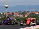 Sebastian Vettel driving the (5) Scuderia Ferrari SF70H and Carlos Sainz driving the (55) Scuderia Toro Rosso STR12 on track during practice for the Formula One Grand Prix of Hungary at Hungaroring on July 28, 2017 in Budapest, Hungary.