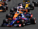 Carlos Sainz of Spain driving the (55) Scuderia Toro Rosso STR12 leads Fernando Alonso of Spain driving the (14) McLaren Honda Formula 1 Team McLaren MCL32 round the first corner at the start during the Formula One Grand Prix of Hungary at Hungaroring on July 30, 2017 in Budapest, Hungary.