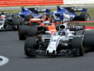 Silverstone, Northamptonshire, UK. Sunday 16 July 2017. Lance Stroll, Williams FW40 Mercedes, leads Stoffel Vandoorne, McLaren MCL32 Honda.