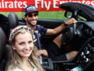 Daniel Ricciardo of Australia and Red Bull Racing drives guests round the circuit in an Aston Martin during previews ahead of the Formula One Grand Prix of Austria at Red Bull Ring on July 6, 2017 in Spielberg, Austria.