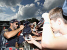 Daniel Ricciardo signs autographs for fans at the fans autograph signing session after qualifying for the Formula One Grand Prix of Austria at Red Bull Ring on July 8, 2017 in Spielberg, Austria.