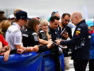 Adrian Newey, the Chief Technical Officer of Red Bull Racing signs autographs for fans before the Formula One Grand Prix of Great Britain at Silverstone on July 16, 2017 in Northampton, England.