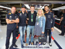 Olympic cycling gold medallist Jason Kenny and his Olympic cycling gold medallist wife Laura pose for a photo with Red Bull Racing Team Principal Christian Horner, Max Verstappen, Daniel Ricciardo Great Britain at Silverstone 2017