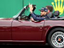 Daniel Ricciardo of Red Bull Racing waves to the crowd on the drivers parade before the Formula One Grand Prix of Great Britain at Silverstone on July 16, 2017 in Northampton, England.
