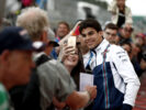 Silverstone, Northamptonshire, UK. Thursday 13 July 2017. Lance Stroll, Williams Martini Racing, has his photo taken with a fan.