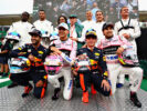 Football and F1 stars including (back row l-r) Louis Saha, Dida, Christian Karembeu, Sir Jackie Stewart, Francesco Toldo, Michel Salgado, David Coulthard, (front row l-r) Daniel Ricciardo of Australia and Red Bull Racing, Esteban Ocon of France and Force India, Max Verstappen of Netherlands and Red Bull Racing and Sergio Perez of Mexico and Force India line up before the karting event during previews for the Formula One Grand Prix of Italy at Autodromo di Monza on August 31, 2017 in Monza, Italy.