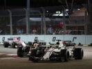 Marina Bay Circuit, Marina Bay, Singapore. Sunday 17 September 2017. Felipe Massa, Williams FW40 Mercedes, leads Kevin Magnussen, Haas VF-17 Ferrari.